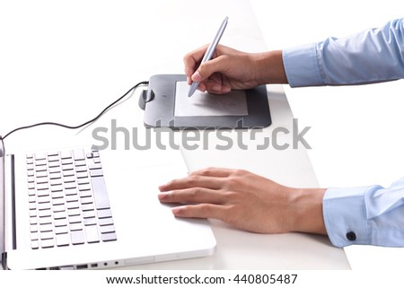 Graphic Designer working with interactive pen display, digital Drawing tablet and Pen on a computer.