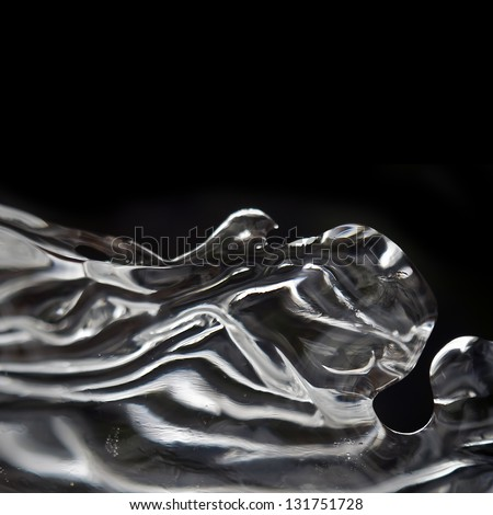 graphic detail of ice in river in macro photography - stock photo