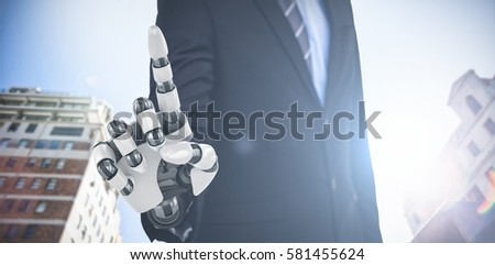 Graphic image of businessman with robotic arm against tall buildings 3d