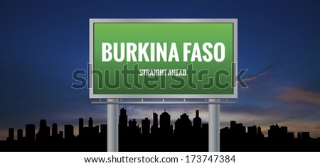 Graphic of a green Burkina Faso Straight Ahead sign on silhouette skyline and sunset background  - stock photo