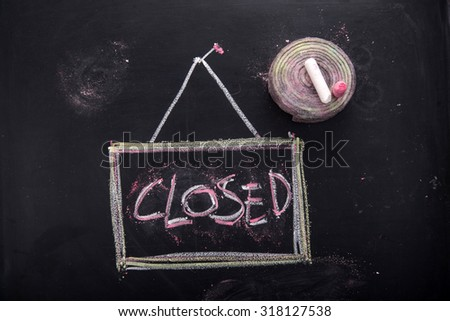 Graphic representation of the word, closed, written with chalk on blackboard - stock photo