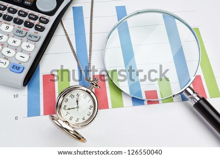 Graphic statistics businessman accessories to Watch, magnifying glass, a calculator. - stock photo