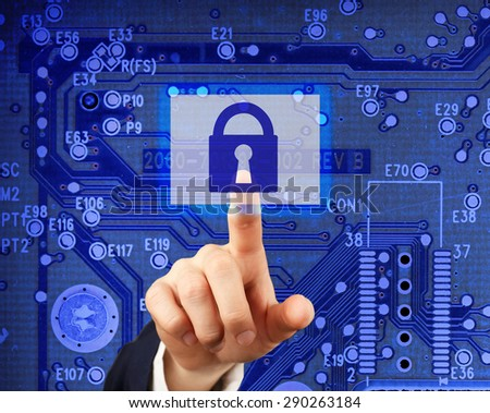 Graphic symbol of a lock on a computer circuit board - computer security system - stock photo