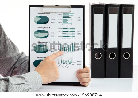 Graphs and charts analyzed by businessman - stock photo