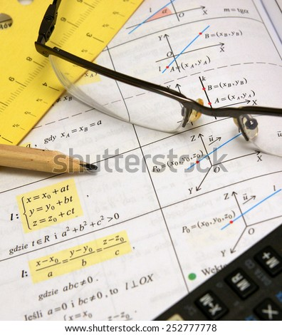 Graphs and charts of vectors (vector) theory together with glasses, calculator and wood pencil (portrait) - stock photo