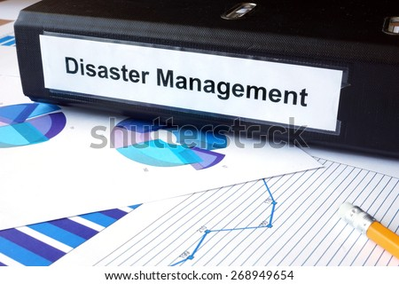 Graphs and file folder with label  Disaster Management. Business concept. - stock photo