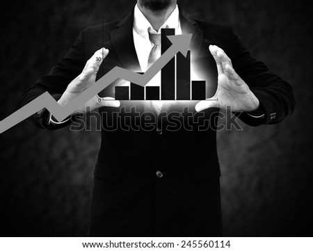 Graphs on the hands of businessmen. - stock photo