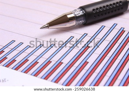 Graphs with pen - stock photo