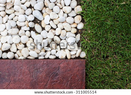 grass bricks and stone landscaping in a nice manicured yard good for textures or a background - stock photo