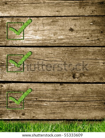 Grass checkbox on a wooden texture - stock photo