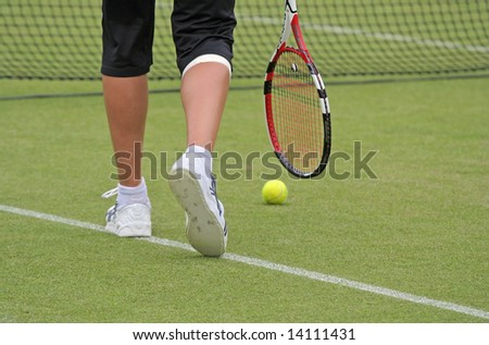 Grass court tennis conceptual picture with legs ball and racket only - stock photo