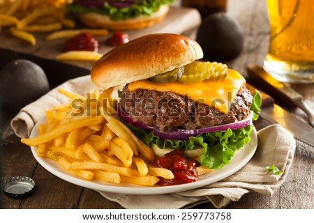 Grass Fed Bison Hamburger with Lettuce and Cheese - stock photo