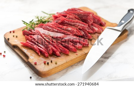 Grass Fed Flank Steak Sliced to Make Beef Jerky - stock photo