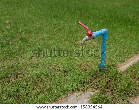 grass field and pipe - stock photo
