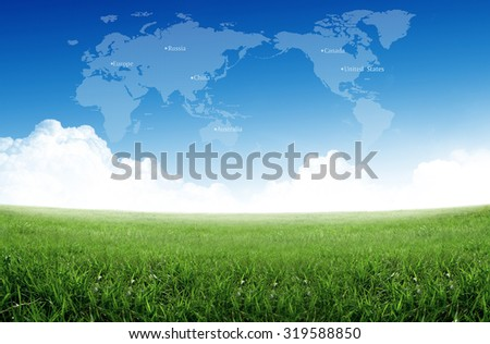 grass field with world map in sky