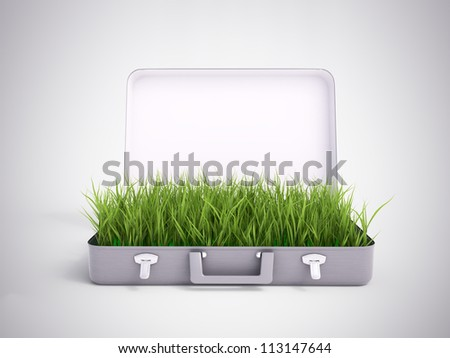 Grass growing out of an open suitcase - green investment - stock photo