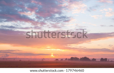 Grass Land Red Sunbeams  - stock photo