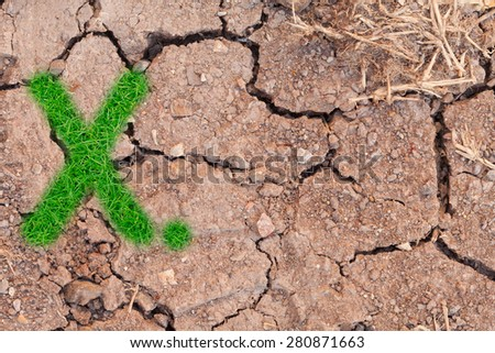 grass number figure on dry crack soil background