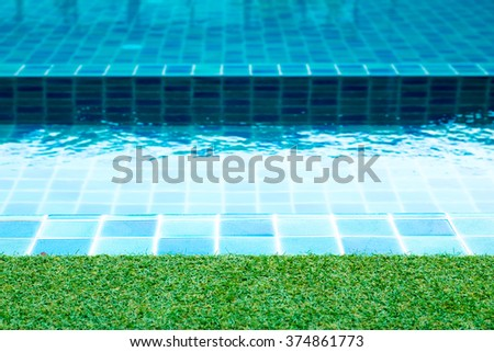 Grass on swimming pool background