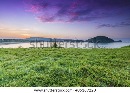 Grass On the Rock at Low Tide Beach at Tanjung Ann, lombok. Taken during sunrise.  - stock photo