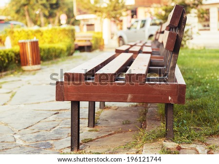 grass park bench day background - stock photo