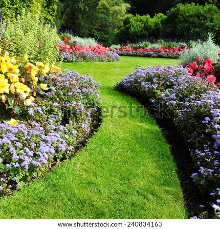 Grass Path and Flowerbed in a Beautiful Garden