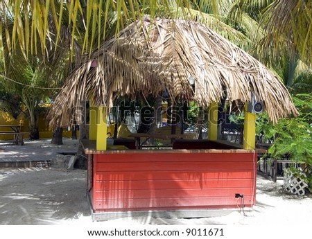 Grass roof bar on sandy tropical beach
