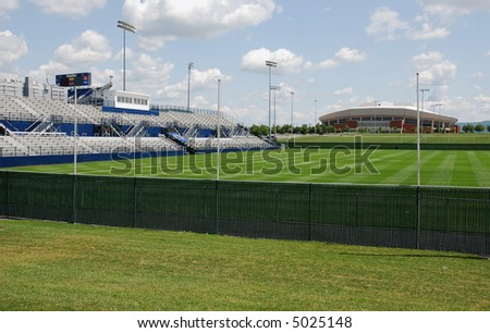 Grass sport field with seats - stock photo