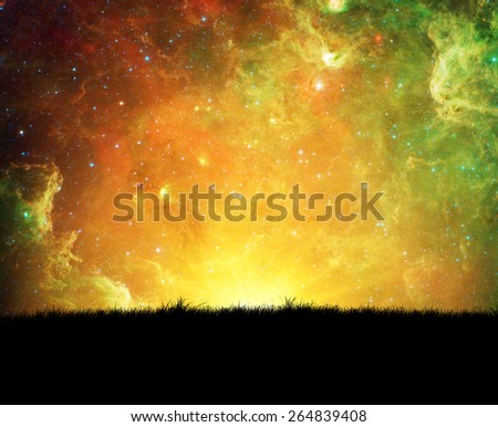 Grass under the night sky and bright sun rays. Elements of this image furnished by NASA - stock photo