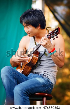 GRASS VALLEY, CALIFORNIA, USA - JULY 14, 2006: Ukulele player Jake Shimabukuro performing onstage at California Worldfest in Grass Valley, California.