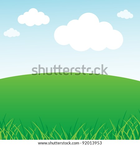 Grassy green field and blue sky - stock photo