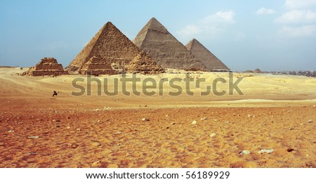 Grate Giza pyramids and blue sky with clouds. - stock photo