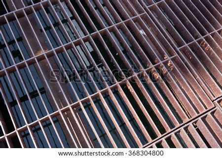 grate on a sewer. - stock photo