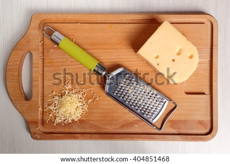 Grated cheese and fine grater - stock photo