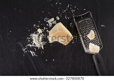 grated cheese, grated parmesan cheese with a grater - stock photo