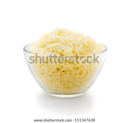 Grated cheese in a transparent plate on a white background. Side view. - stock photo