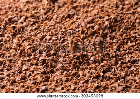 Grated chocolate background. Shallow DOF