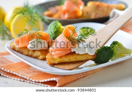 Grated fried potatoes with smoked salmon and creamed horseradish sauce - stock photo