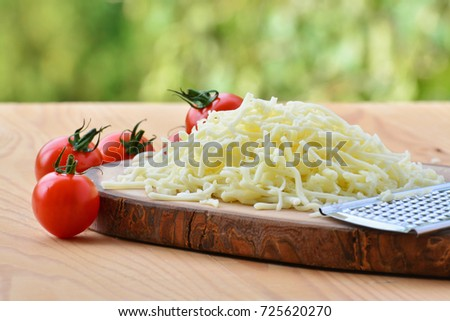stock-photo-grated-mozzarella-cheese-and