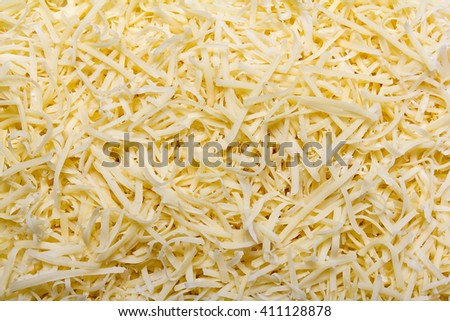 Grated pizza cheese (mozzarella ) close up texture