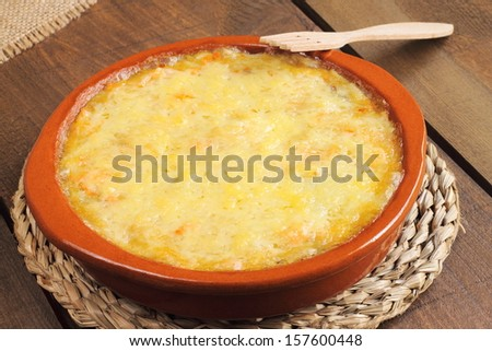 Gratin dauphinois, a traditional regional French dish based on potatoes and creme fraiche cooked in a slow oven - stock photo
