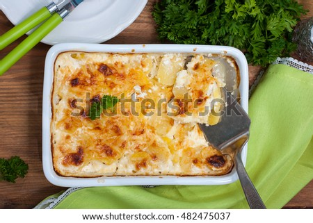 Gratin potatoes with cheese, top view