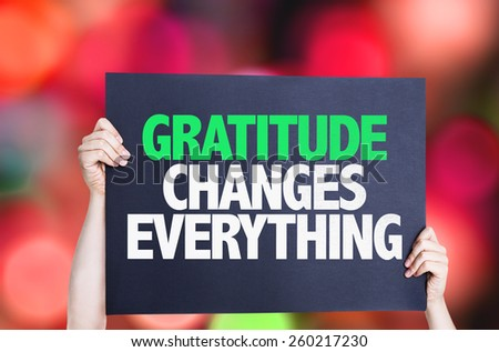 Gratitude Changes Everything card with bokeh background - stock photo