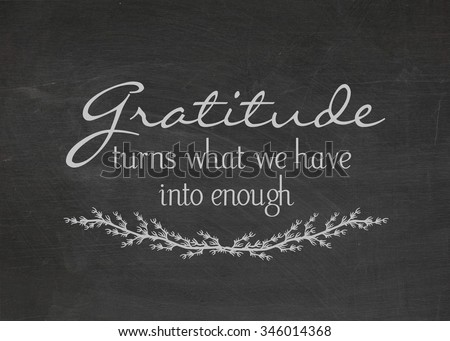 gratitude quote on a dusty black chalkboard - stock photo