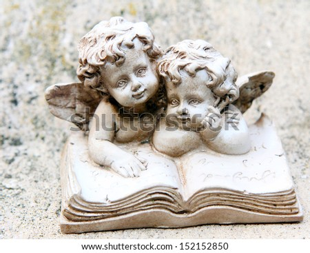 Grave angel before grave stone - stock photo