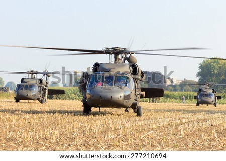 GRAVE, NETHERLANDS - SEP 17: American Black Hawk helicopters in a field at the Operation Market Garden memorial on Sep 17, 2014 Grave, Netherlands. Market Garden was a large Allied operation in 1944. - stock photo