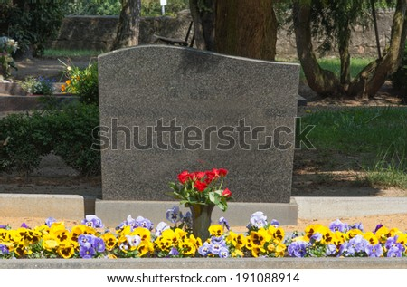 Grave stone with empty text box / cemetery - stock photo