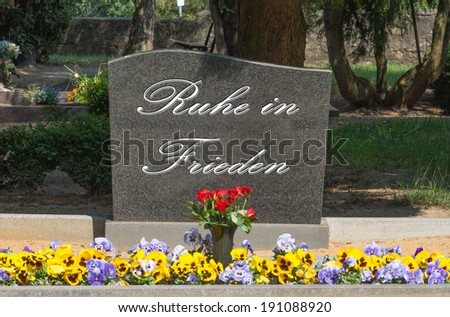 Grave stone with the german words Rest in peace / cemetery - stock photo