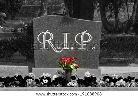 Grave stone with the word RIP in black and white / cemetery - stock photo