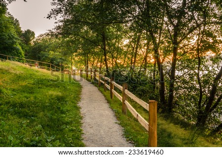 Gravel Path to a Recreational Area at Sunset - stock photo